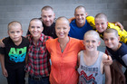 Nick Reeder, Sarah Jane Little, Patrick McDaniel, Meg Ryan, Dave Taylor, Toby Miller (front) Ryan Taylor, and Rylan Griffin all shaved their heads for the cause. Photo/Andrew Warner