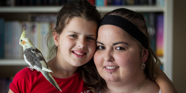 Loading Cancer sufferer Heather Moore with her daughter Ayla Robinson, 11, and pet bird Walnut. Photo / Jason Oxenham