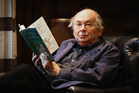Sir Quentin Blake holds an annotated page by Quentin Blake from Roal Dahl's Charlie and the Chocolate Factory.