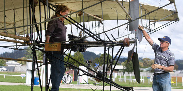 Engineer Alan Booth (left) stands by the controls while test pilot Neville Hay (right) is pictured at Whitianga Airfield. Photo / Alan Gibson