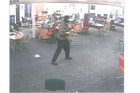A CCTV image of Russell John Tully during his armed attack on the Winz office in Ashburton on September 1, 2014. Photo / Supplied