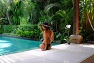 'Luxe traveller' Jill DeConti cools off by the pool in Bali. Photo / Supplied
