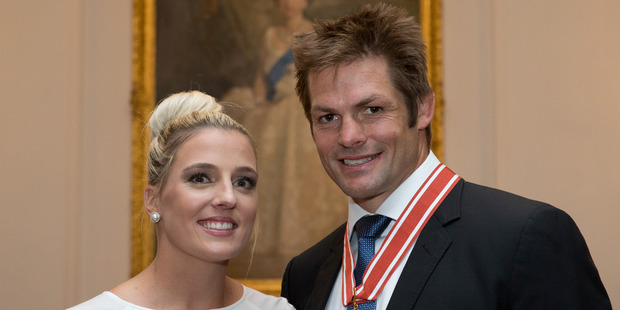 Loading Former All Blacks captain Richie McCaw with his fiance Gemma Flynn after receiving the Order of NZ at Government House in Wellington. Photo / Mark Mitchell