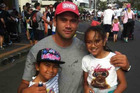 Former Blues rugby player Kurtis Haiu and his daughters, Sienna, 6, (left), and Aaliyah, 8 during the Round The Bays run. Photo / Supplied