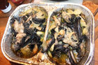 Paua sliced and baked for two hours with onions and garlic can be cut with a fork. Photo / Geoff Thomas