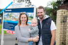 First time home hunters, Gemma Mann and Mike Alsweiler with their son Harper. Photo / Michael Craig