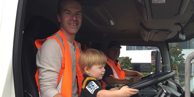 Loading Alex with Dad Aaron and rubbish truck driver Darryl. Photo / Nick Reed