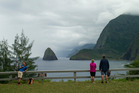 Hikers overlook a bluff on the Kalaupapa Peninsula in Kalawao, Hawaii. Photo / AP