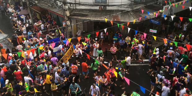 Revelers douse each other with water during the Songkran water festival. Photo / AP
