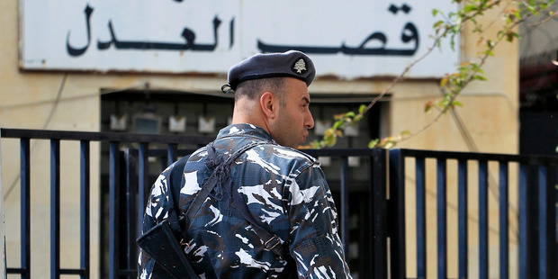 A Lebanese policeman stand guards at the entrance of the courthouse. Photo / AP