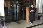 Barista Ri Hyon A stands in front of the Kumrung coffee shop in Pyongyang. Photo / AP
