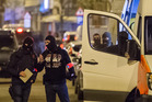Police investigate an area where terror suspect Mohamed Abrini was arrested in Brussels on Friday. Photo / AP