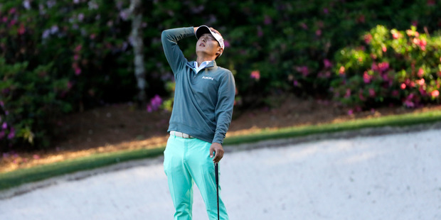 Danny Lee, of New Zealand, reacts after his putt on the 13th green during the third round of the Masters golf tournament Saturday. Photo / AP.