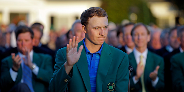 Loading Defending Masters champion Jordan Spieth waves during presentation following the final round of the Masters golf tournament Sunday, April 10, 2016, in Augusta, Ga. (AP Photo/Chris Carlson)