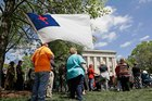 Supporters gather for a rally outside the North Carolina State Capitol in Raleigh, in support of a law that blocks rules allowing transgender people to use the bathroom of their choice. Photo / AP
