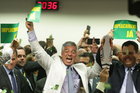 Opposition lawmakers celebrated the committee's decision. Photo / AP