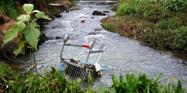 A discarded trolley and other rubbish in Otara Creek. Photo / File