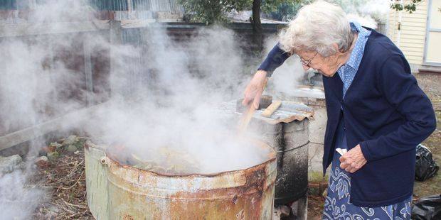 Pat Hewitt stirs the copper containing silver dollar leaves at the Dannevirke Spinners and Weavers dye day on Saturday.