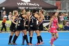 YEAH BABY: Scorer Olivia Merry celebrates the Black Sticks' opening goal with as a dejected Japan captain Miyuki Nakagawa walks away in the final in Hastings today. PHOTO/Duncan Brown