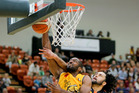 Hawks forward Daryl Jones tries to stop Taranaki Mountainairs import Marcus Johnson from adding two points in Napier tonight. PHOTO/Warren Buckland