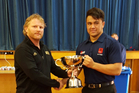 PRESENTATION TIME: HBHS 1st XV rugby captain Kianu Kereru Symes (right) receives the Graham Thomas Challenge Cup from Thomas' son, Craig, who is an old boy of HBHS. PHOTO/SUPPLIED