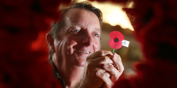 Chris Harold from the Whangarei RSA holds a poppy that will be available to the public on Friday. Photo / Michael Cunningham