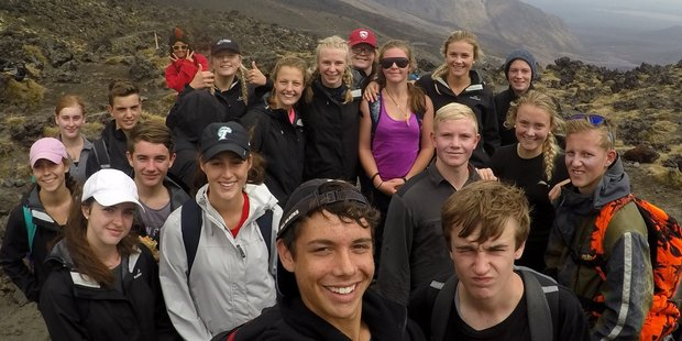 Wairarapa College Year 12 geographer Isaac Bracewell (centre) takes a group selfie in the volcanic environment at Tongariro. PHOTO/ISAAC BRACEWELL