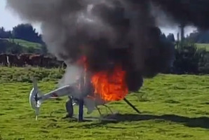 The helicopter on fire at Tikitere.   Photo/Rob Tane