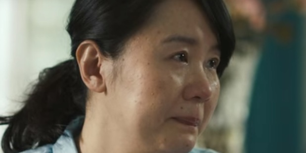 """A young woman cries as her mother says she's a """"leftover women"""" because she's not pretty. Image / SK-II"""