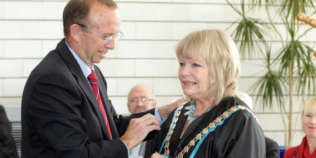 THE VOTES ARE IN: Annette Main receives the mayoral chain of office from then chief executive Kevin Ross after the October 2013 election.PHOTO/FILE