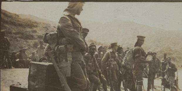 Members of the Maori Contingent gathering on the beach at Gallipoli. Photo / courtesy of Auckland War Memorial Museum - Tamaki Paenga Hira. Williams Album (1915), PH-ALB-212-15-2