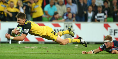 Beauden Barrett dives over for his second try against the Rebels. Photo / Getty
