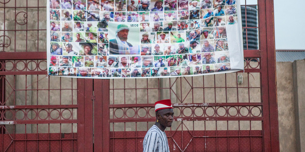 A Boko Haram's 'Most Wanted' poster hangs on a gate in Maiduguri, Nigeria. Photo/ The Washington Post by Jane Hahn.