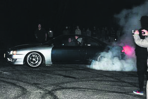 A car mid-burnout. PHOTO/2DOORSPHOTOGRAPHY