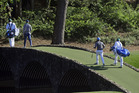 Jordan Spieth, left, crosses over the Hogan Bridge with Rory McIlroy during the Masters. Photo / AP