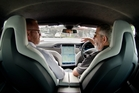 Rotorua Daily Post reporter Matthew Martin (left) gets a ride in the Tesla P90D Model S with owner Sean Dick.