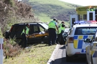 EMERGENCY: Police and St John staff load the driver of the crashed vehicle into an ambulance.PHOTO/NZME