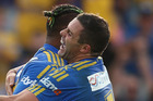 Ken Edwards of the Eels celebrates with his team mate Michael Gordon of the Eels after scoring a try against the Canberra Raiders. Photo / Getty Images