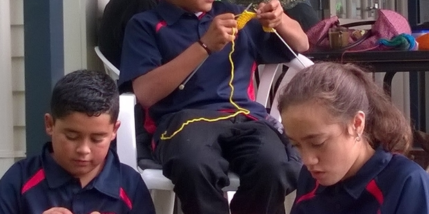 CONCENTRATION: Darlaney Hina-Pauro, Malcolm Nahona and Ariki (Chick) Ratana practise their new craft. PHOTO/SUPPLIED