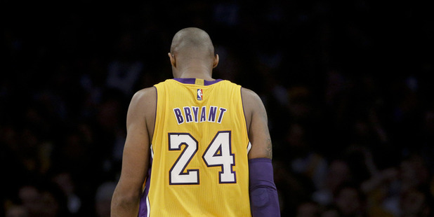 Los Angeles Lakers forward Kobe Bryant walks down the court during the first half of Bryant's last NBA basketball game. Photo / AP
