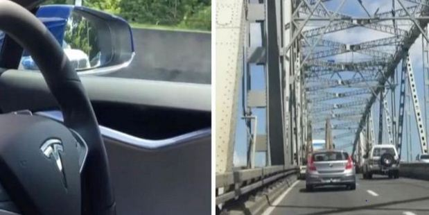Loading The Tesla S drives autonomously along Auckland's motorway. Photo / Supplied