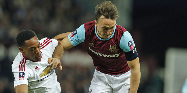 Mark Noble and West Ham went down 2-1 to Manchester United. Photo / AP