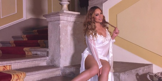 Mariah Carey appeared to spend most of her time at the Villa Napoleon I in silky white lingerie. Photo / Instagram, Mariahcarey