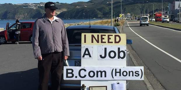 Loading The man has been standing on the Petone foreshore with a sign asking for work. Attached to the sign is an honours degree in commerce. Photo / Facebook