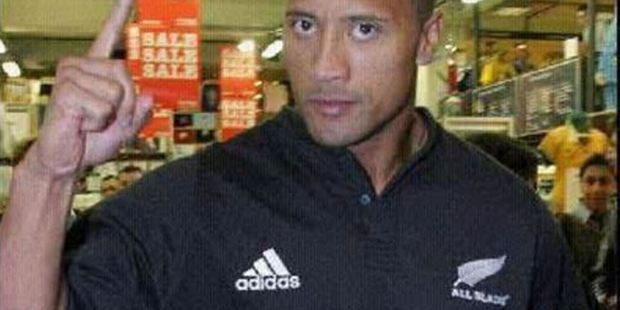 The Rock wears his All Blacks jersey with pride.