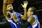 Dion Prewster of the Wellington Saints makes an intercept with team mate Leon Henry. Photo / Photosport