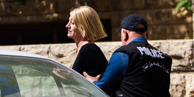 TV presenter Tara Brown is escorted from court on April 18, 2016 in Beirut, Lebanon. Photo / Getty Images