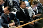 The former Prime Minister was snapped sitting alongside Oscar-winning actor Leonardo DiCaprio during the signing of the Paris Agreement on climate change. Photo / AP