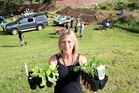 COMMUNITY OFFERING: Celeste Arbuckle with some vegetable plants she brought along for the new Matai St community garden.PHOTO/STUART MUNRO