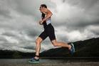 Rotorua's Sam Osborne legs it along the Lake Tikitapu shoreline in the men's pro race at Xterra Rotorua on Saturday. Photo / Stephen Parker